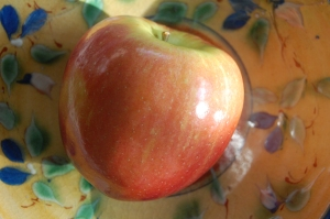 APPLE ON FLOWERED PLATE